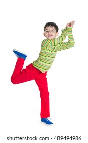 A cheerful little boy jumps on the white background