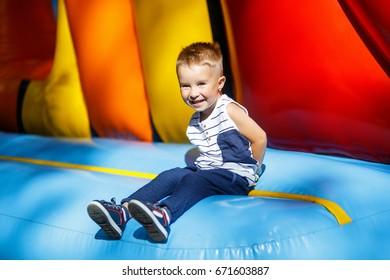Cheerful little boy outdoors