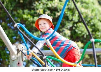 cheerful little boy at the playground