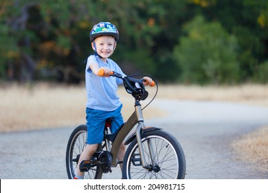 cheerful little boy riding bicycle