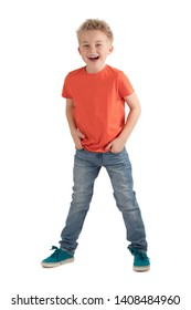 CHEERFUL LITTLE BOY SMILING HAPPY WITH HANDS IN POCKETS ISOLATED ON WHITE BACKGROUND