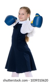 A cheerful little girl in boxing gloves. The concept of sport, children's emotions. Isolated on white background.