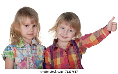 A cheerful little girl is holding her thumb up and her friend is disappointed; isolated on the white background