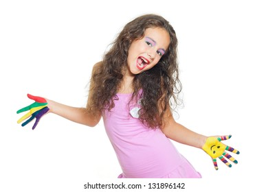 cheerful little girl is playing with colors