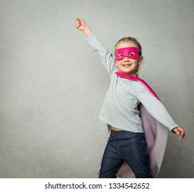 Cheerful little girl is a superhero
