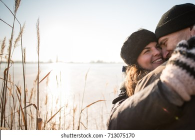 Cheerful love couple embracing each other tightly