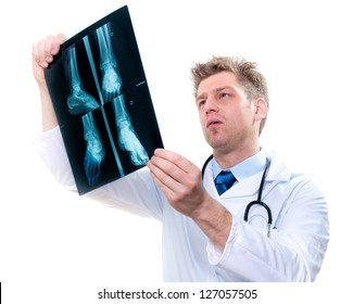 cheerful male doctor examining feet x-ray