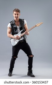 Cheerful male rocker with cool musical instrument