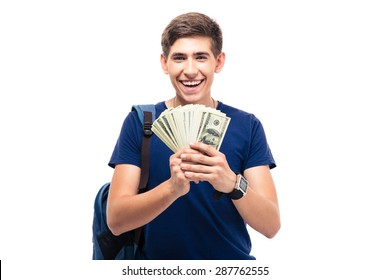 Cheerful male student holding money isolated on a white background. Looking at camera