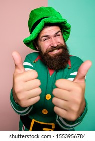 Cheerful man celebrate holiday. Christmas elf. Elf concept. Happy celebration. Bearded elf. Winter carnival. Best day ever. St Patricks day. Hipster with beard wearing green party costume thumbs up.