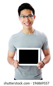 Cheerful man in glasses showing tablet computer screen over white background