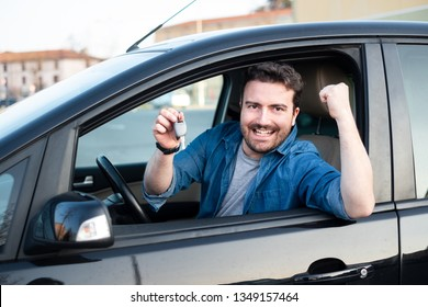 Cheerful man happy after buying new car