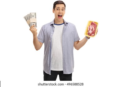 Cheerful man holding bundles of money and a steak isolated on white background
