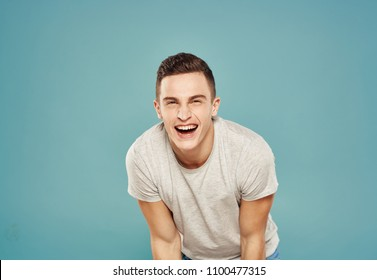 cheerful man on a blue background ,short haircut