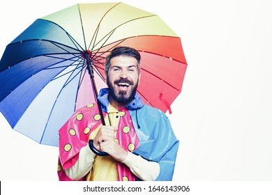 Cheerful man rejoices in autumn sales. Autumn mood and the weather are warm and sunny and rain is possible. Funny face. Beautiful young man with beard having fun with Leaf fall. Autumn time