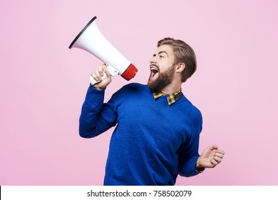 Cheerful man shouting into megaphone