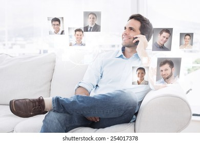 Cheerful man sitting on the couch making a phone call against profile pictures