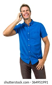 Cheerful man talking on mobile phone against white background