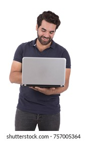 cheerful man is using his laptop. Isolated on white background.