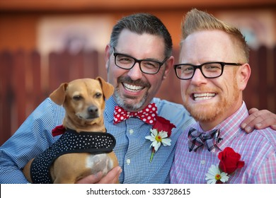 Cheerful married gay couple outdoors with dog