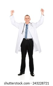 Cheerful mature male doctor with raised arms.