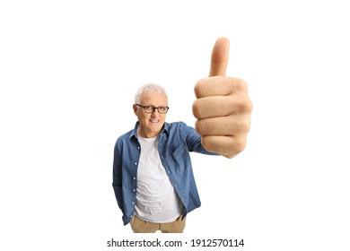 Cheerful mature man in casual clothes showing thumbs up in front of camera isolated on white background