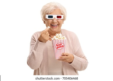 Cheerful mature woman with 3D glasses having popcorn isolated on white background