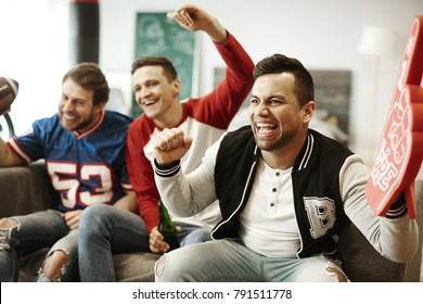 Cheerful men supporting their sport team