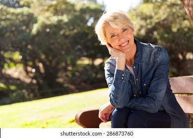 cheerful mid age woman looking at the camera