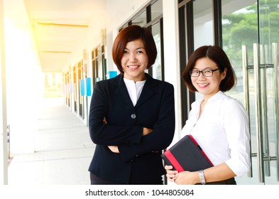 Cheerful middle aged asian businesswomen