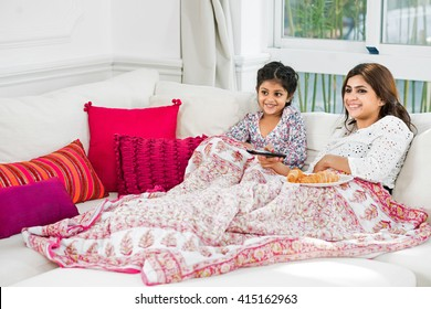 Cheerful mother and daughter enjoying weekend at home