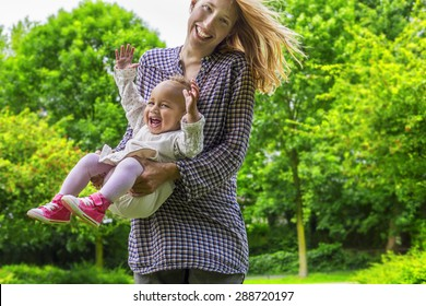 Cheerful mother and daughter on a sunny day