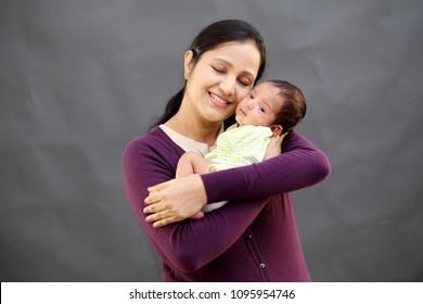 Cheerful mother and newborn baby