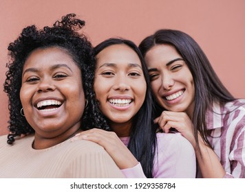 Cheerful multiracial women with different skin color looking in camera - Concept of friendship and happiness
