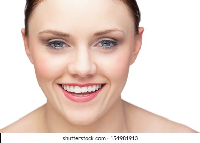 Cheerful natural model posing on white background