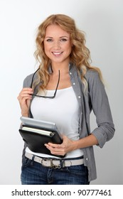 Cheerful office worker with electronic tablet and agenda
