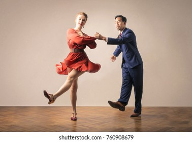 Cheerful old fashioned couple dancing together