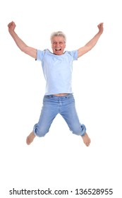 cheerful old man jumping on a white background