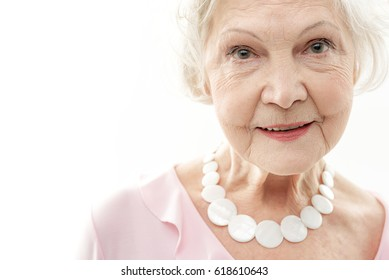 Cheerful old woman expressing positive emotions