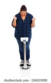 cheerful overweight girl on scale successful weight loss