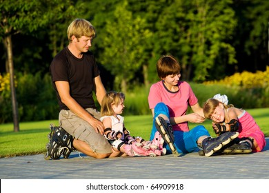 Cheerful parents and kids in roller skates