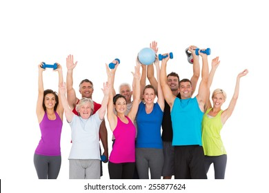Cheerful people holding exercise equipment on white background