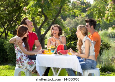 Cheerful people at a picnic. Cheerful people enjoy a day at the park