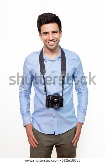 Cheerful photojournalist looking at camera