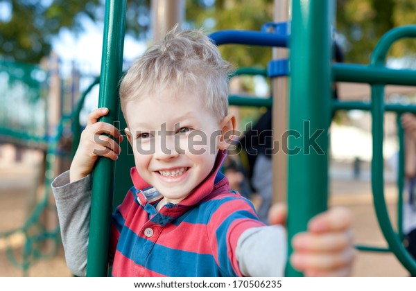 cheerful positive kid spending fun time at the playground