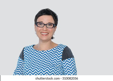 Cheerful positive woman with eyeglasses and white teeth, concept of clear vision. Isolated, with copy space.