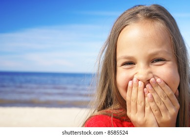 Cheerful preteen girl on a beach