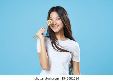 Cheerful pretty woman holding chopsticks sushi diet food snack Studio Model