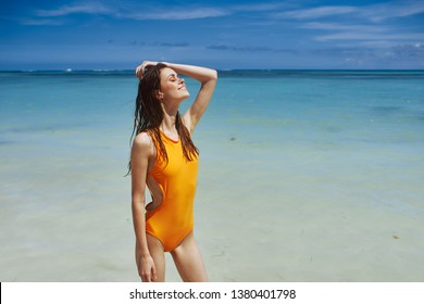 Cheerful pretty woman in a yellow bathing suit swimming in the ocean rest nature tropics