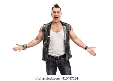 Cheerful punk rocker in an old jacket with pins and badges gesturing with his hands isolated on white background
